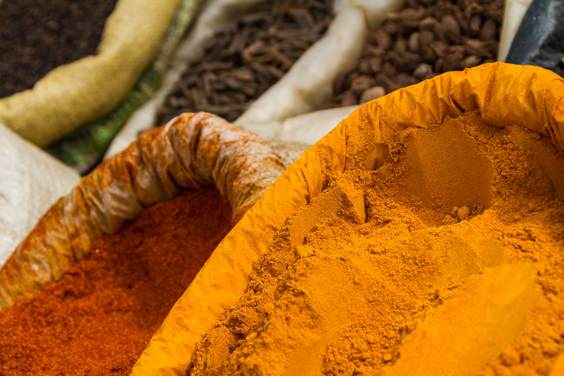 Brightly colored spices at an open market in Kathmandu, Nepal